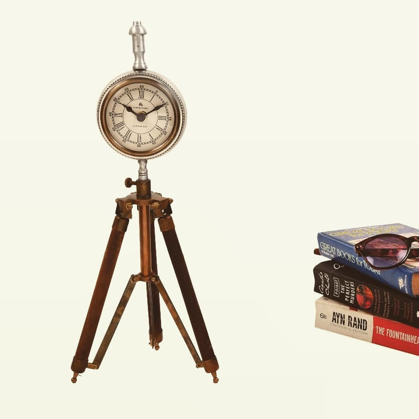 Highlight the corner cable with this antique style tripod clock! www.manorhouse.in #clock #tabledecor #tripod #time #manorhousedecor #lovefordesign