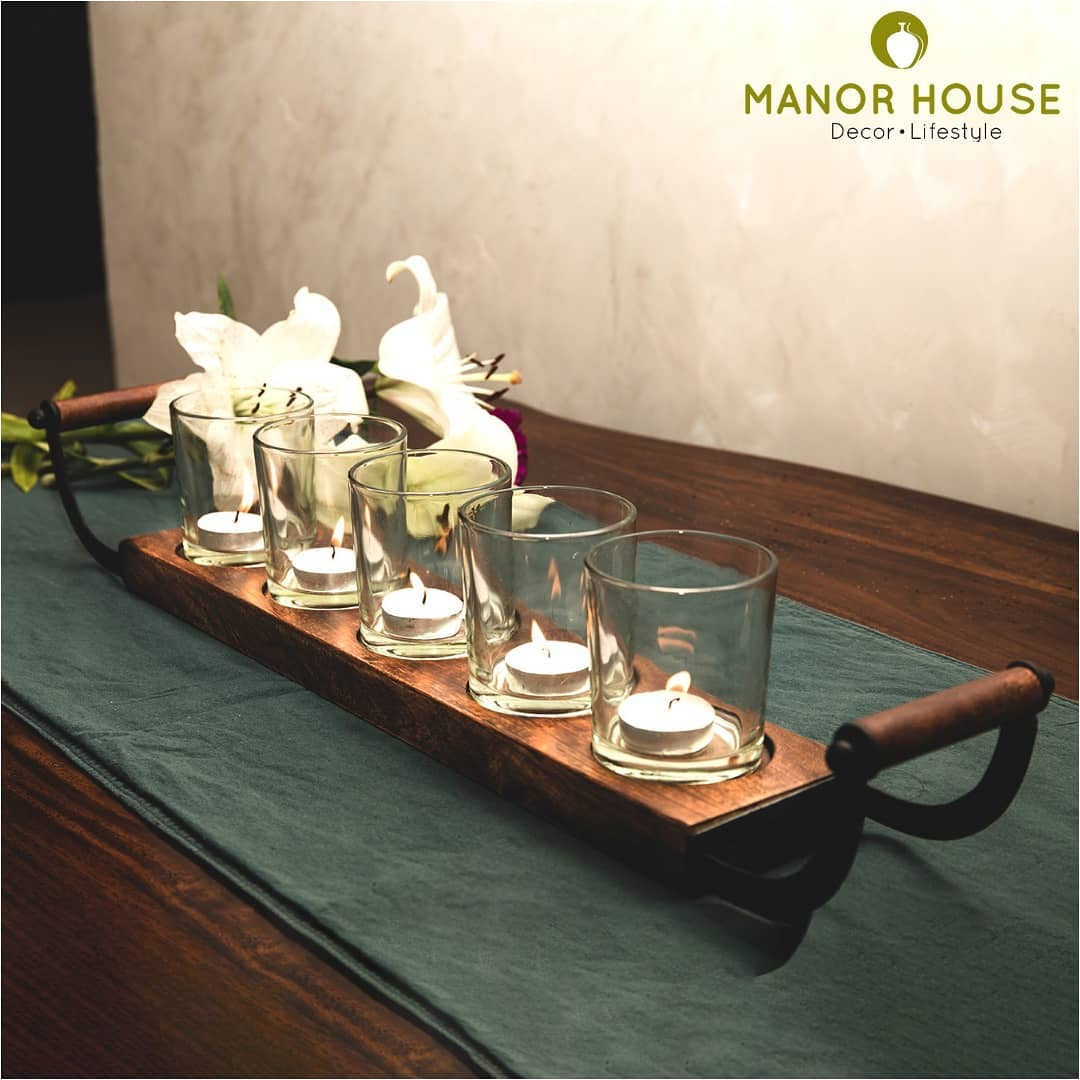 Starting preparations for the festive season ahead. The tealight table runner @manor_house_decor along with fresh flowers would be a marvelous centerpiece. We packed few cookies and edible goodies in the tealight stands and these made  fantastic hampers #hampers #rakhihampers #rakshabandhan #manorhousedecor #homedecor #homedecoration #housetohome #beautifulhouse