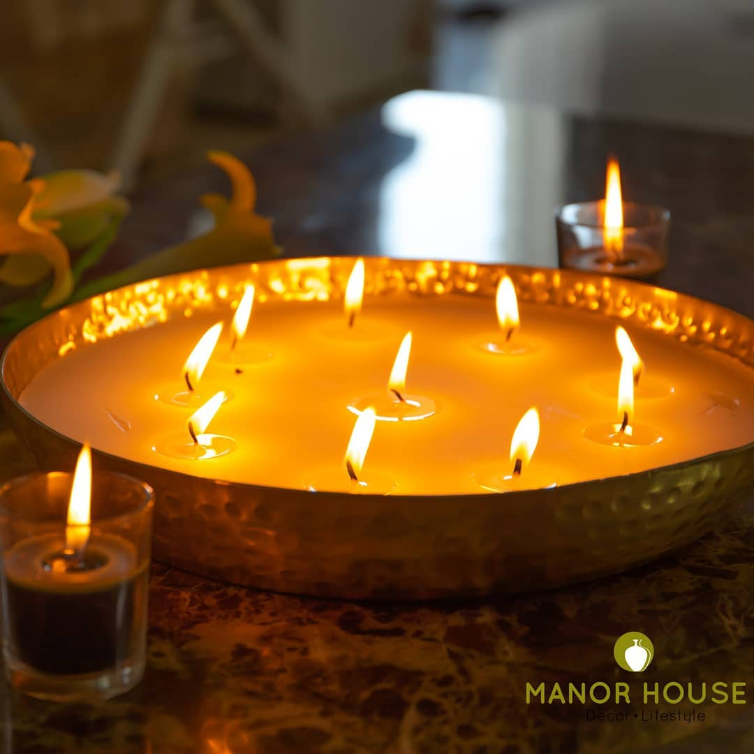 Candles are never enough. Our multiwick candles in repurpose metal urlis are so elegant. Keep them or gift them. You will love them as much as we do.  @manor_house_decor #manorhousedecor #homedecor #homedecoration #candles #gift #diwaligift #diwali2019 #diwalidecor #weddingdecor #anniversaryparty #decorationideas #urli #metalgifts #interiorstyling #beautifulhomes