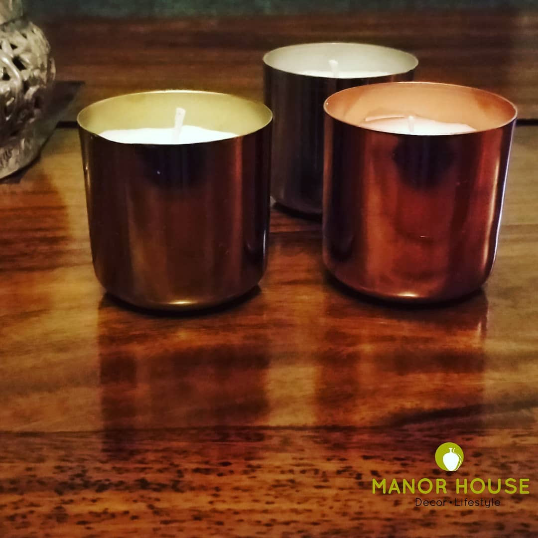 Bonkers over candles this festive season or looking for quick gifts which are stylish, elegant and useful? Look no further. Our vanilla candles filled in metal jars will light up your 💓. @manor_house_decor #homestyle decor tip: Some rose petal leaves or mogra sprinkled around these essenced candle jars are wonderful festive corner decor DM us or call us  #homedecor #homedecoration #beautifulhomes #candles #tealights #diwali2019 #weddingdecor #diwaligift #candleholder #interiorstyling