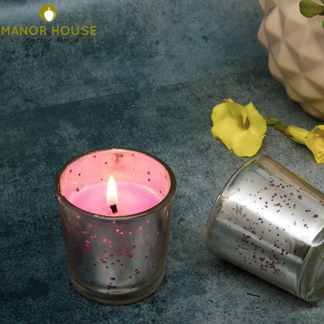 Candles filled in glass votives are loved by everyone. Mirrored finish in votives will give a pretty jaali effect when lit. #lit #candle #tealights #tealightcandle #manorhousedecor #manorhouse #homedecortips #decorinspo #homedecoration #diwaliparty #christmasdecor