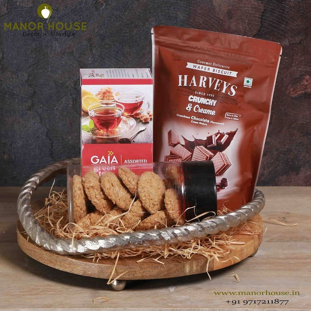 Chitra Rope Tray Hamper  Contents: Wood and Metal Tray GAIA Green Tea 1 Pack Oat Biscuits Harvey Crunchy and Creme 2 Rakhis and Tika Cling Wrapped   #architecturedesign #estyart #bestofetsy #etsysellers #gifts #rakhihampers #hampers #gifting #giftsforbrother #giftforsister #usefullgift
