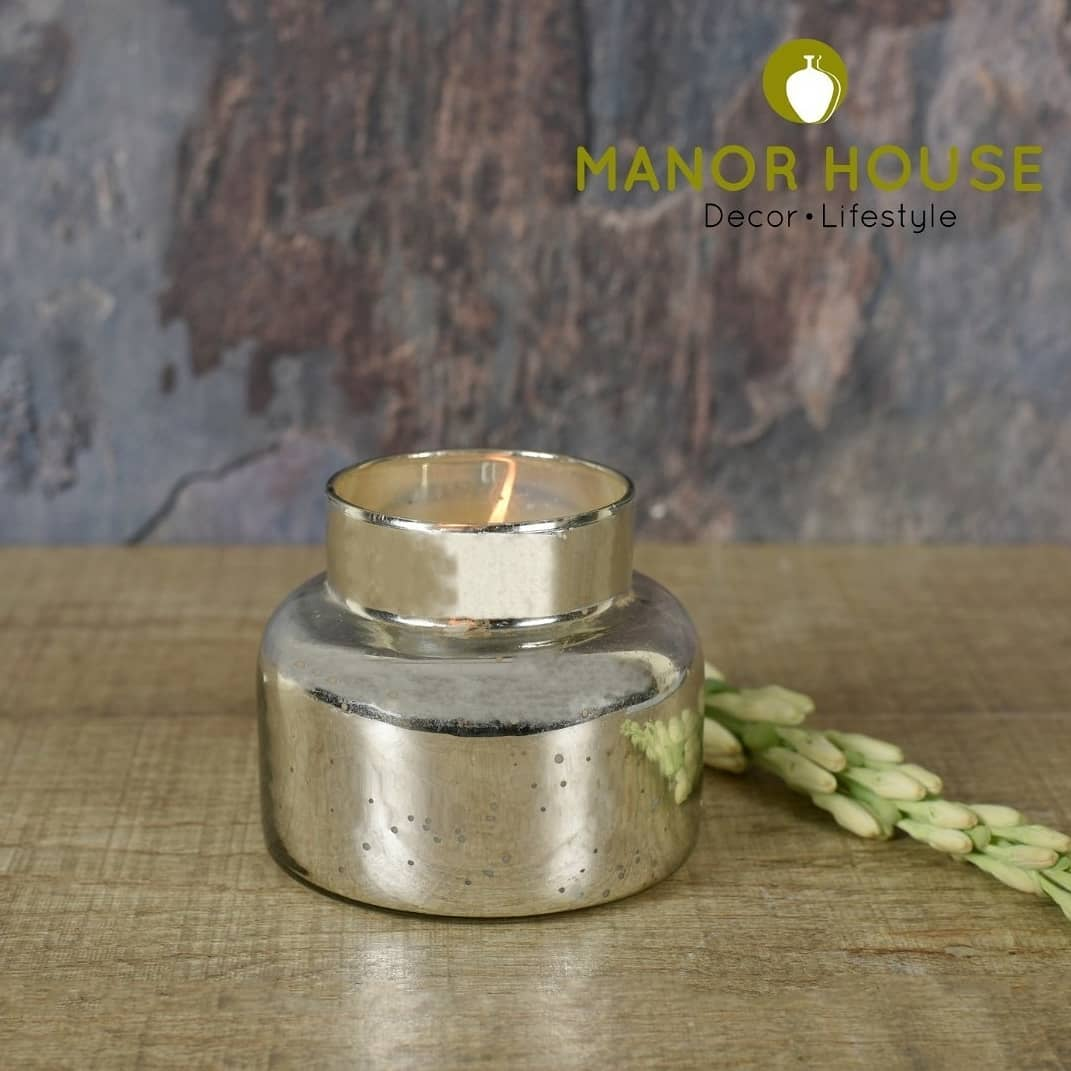 Enhance the ambience of your décor! Buy this Mercury Glass Jar filled with flavored candle and wooden lid. This 4.5 inches tall showpiece candle gives a add on to your home decor . . . . #candleholders #candles #candlesandmore #manorhouse #urbanhomes #india #delhi #home4u #ethnictouch #tablesetting #tablesettingideas #diy #homestore #tablesetup @blomminghomeee @transformation_tales @home_iswhereheartis @raw_all_india @urbancompany_homes @creative_homestyles #handmade #homedecor #love #candlelover #candlelight #home #candlemaking #candleaddict #candlesofinstagram #fragrance #decor #instagood #photooftheday #scentedcandles #gift #smallbusiness
