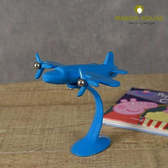 This 7 inch tall sculpture with blue finish is perfect to enhance the ambience of your child's room. Place on the study table or even in your office space. This beautiful showpiece comes in three colors – blue, ivory and green. . . . . . #monday #mondaymood #airplane #flight #childrens #giftforchildrens #playarea #creativehomes #homedecor #manorhouse  #beautifulhomes #tabletops #tableacessories #deskacessories #tablescapes #tabledecor #urbanhomes #india #delhi #tablesetting #tablesettingideas #homestore #tablesetup @blomminghomeee @transformation_tales @home_iswhereheartis @raw_all_india @urbancompany_homes @creative_homestyles #handmade #homedecor #love #home #decor #instagood #photooftheday