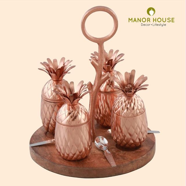 Upgrade to this Pineapple shaped jar set with wooden base tray and metal handle that gives an elegant look. Pineapples are attached to the tray through magnets, which make them topple free. It is ideal for serving sauf, cardamom etc after lunch/dinner to your guest. . . . . #serveware #tableware #dinnerware #afterlunch #pineapple #jar #containers #homestyling #homedecor #tabledecor #corporategifts #gifting #decor #giftingideas #manorhouse #urbanhomes #homestore #tablesetup @blomminghomeee @transformation_tales @home_iswhereheartis @raw_all_india @urbancompany_homes @creative_homestyles #handmade #homedecor #love
