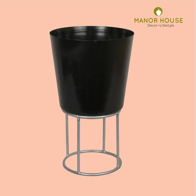 Bring some greenery inside your home with manor house black planter that comes with metal riser. The stand will provide elevation and can be placed on a table top too because of its handy size. Place your order at www.manorhouse.in . . . . #planters #manorhousedecor #homedecor #homedecoration #indoorplants #planter #giftingideas #rakshabandan #festivals #festiveready #homedecor #manorhouse #uchomes #beautifulhomes #diy #idea #beautifuldecor #urbanhomes #india #delhi #homestore @blomminghomeee @transformation_tales @home_iswhereheartis @raw_all_india @urbancompany_homes @creative_homestyles #handmade #homedecor #love #home #decor #gift #supportsmallbusiness #blackplanter